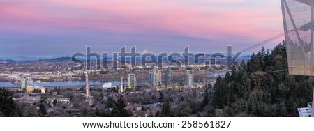 Portland Oregon South Waterfront with Ross Island Bridge Tilikum Crossing and Mount Hood during Alpenglow Sunset Panorama - stock photo