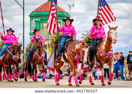 Portland, Oregon, USA - June 11, 2016: 40 Something Cowgirls in the Grand Floral Parade during Portland Rose Festival 2016. - stock photo