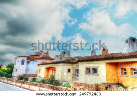 Porto Cervo buildings under a dramatic sky. Processed for hdr tone mapping effect. - stock photo