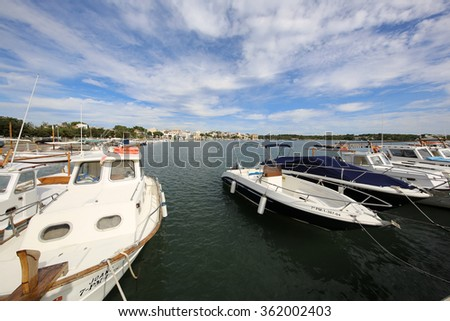 Porto Colom, Spain - October 24, 2015: Boats on Harbor in Porto Colom. Porto Colom is a small town on the eastside of Majorca. It has a large natural Harbor.  - stock photo