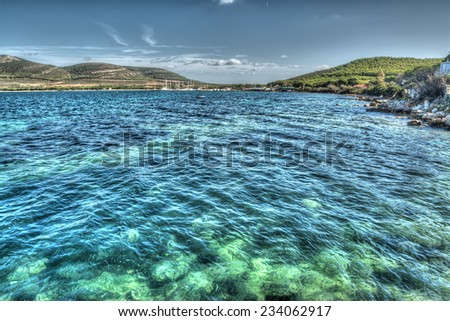 Porto Conte shore on a clear day. Processed for hdr tone mapping effect. - stock photo