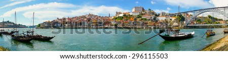 Porto old town skyline on the Douro River with rabelo boats - stock photo