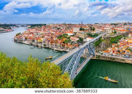 Porto, Portugal cityscape on the Douro River and Dom Luis I Bridge. - stock photo