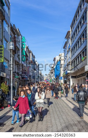 Porto, Portugal. December 29, 2014: Santa Catarina Street, the main shopping street of the city, full of shoppers during the end of the year festivities. - stock photo