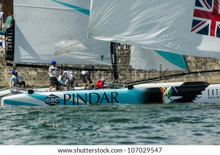 PORTO, PORTUGAL - JULY 07: GAC Pindar compete in the Extreme Sailing Series boat race on july 07, 2012 in Porto, Portugal. - stock photo