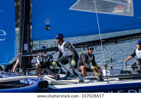 PORTO, PORTUGAL - JULY 07: The Wave - Muscat compete in the Extreme Sailing Series boat race on july 07, 2012 in Porto, Portugal. - stock photo