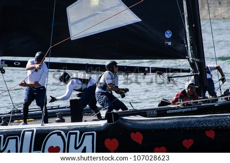 PORTO, PORTUGAL - JULY 07: ZouLou compete in the Extreme Sailing Series boat race on july 07, 2012 in Porto, Portugal. - stock photo