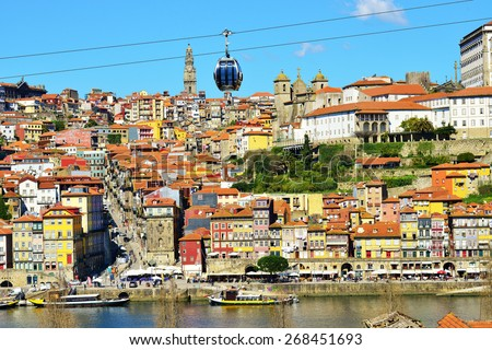PORTO PORTUGAL, MARCH 2015. Old colorful houses in old part of Porto and cable car over  Douro river - stock photo