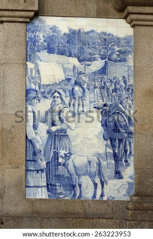 Porto, Portugal - March 4, 2015: Sao Bento railway station with famous tiles, installed between 1905 and 1906 by artist Jorge Colaco. This panel represents a country fair scene from XIX century. - stock photo