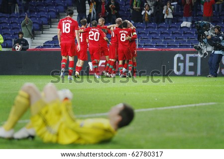 PORTO, PORTUGAL - OCTOBER 8: Portuguese players celebrate their 1st goal in the Euro 2012 Group Stage Qualifying match against Denmark on October 8, 2010 in Porto, Portugal - stock photo