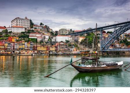Porto, Portugal skyline on the Douro River at dusk. - stock photo