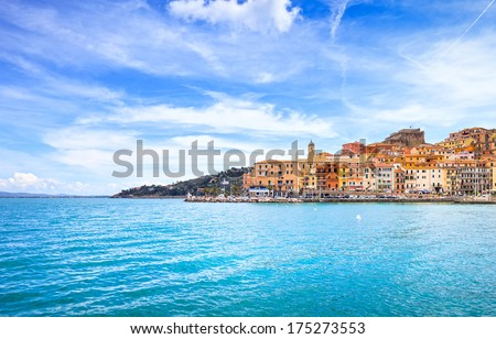 Porto Santo Stefano harbor seafront and village skyline., italian travel destination. Monte Argentario, Tuscany, Italy. - stock photo