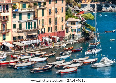 PORTOFINO, ITALY - AUGUST 05, 2011: Boats and colorful houses of Portofino - small village and popular tourist resort on Italian Riviera, famous for its picturesque harbor and celebrity visitors. - stock photo