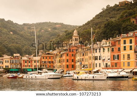 Portofino - Ligurian coast, Italy : warm light in the bay on a cloudy day - stock photo