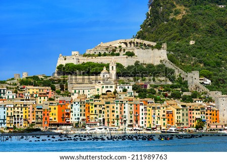 Portovenere - Liguria Italy / View of Portovenere or Porto Venere (UNESCO heritage), seen from the Island of Palmaria. In the foreground cultivation of mussels - stock photo