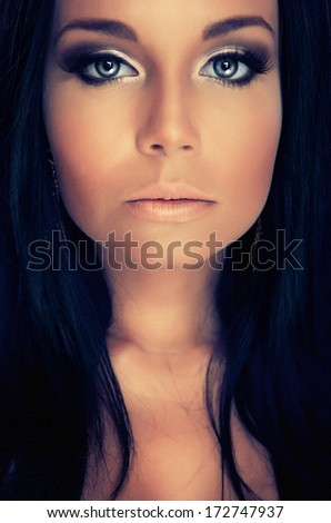 portrair attractive girl with blue eyes and dark lashes - stock photo