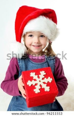 portrait a smiling girl with santa hat - stock photo