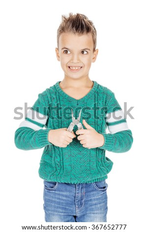 Portrait adorable young happy boy with the pliers on white studio background. - stock photo