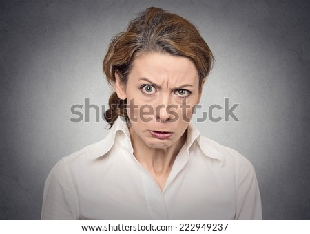 portrait angry woman on grey background  - stock photo