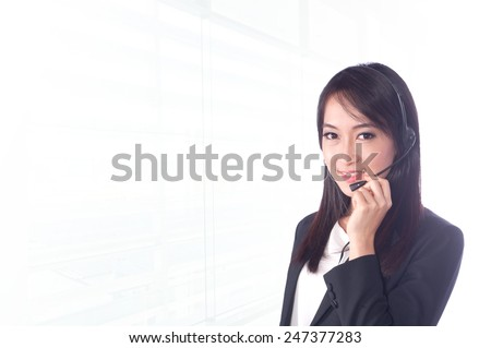 portrait asian businesswoman or call center 20 - 30 year old with long hair has office background.Mixed Asian / Caucasian businesswoman.Positive emotion - stock photo