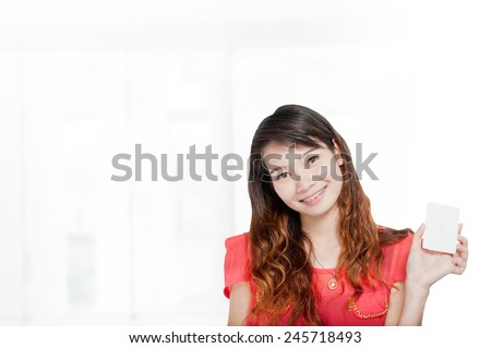 portrait asian businesswoman 20 - 30 year old with long hair showing ok sign has shopping mall background.Mixed Asian / Caucasian businesswoman.Positive emotion - stock photo
