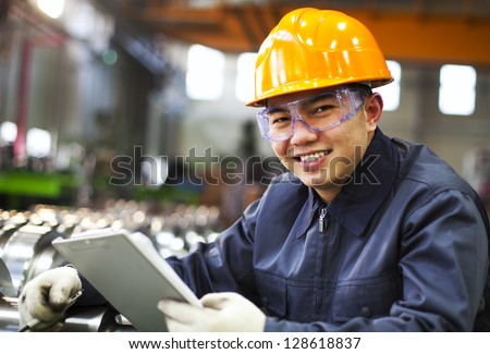 Portrait asian engineer with checklist look on you camera - stock photo