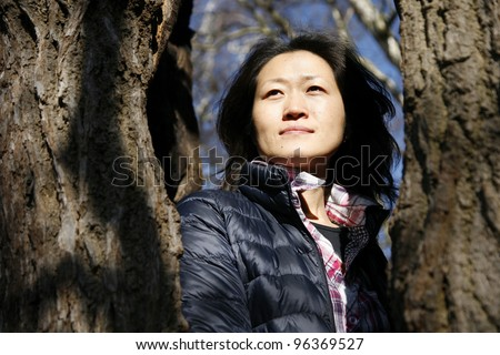 Portrait asian woman, looking off into distance - stock photo