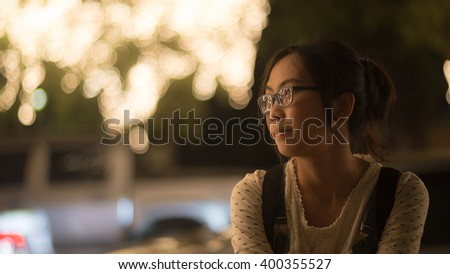 Portrait asian woman. Smile and happy in lighting night. - stock photo