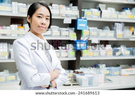 Portrait Asian women pharmacists in front of the class dispensing pharmacist in Pharmacy - stock photo