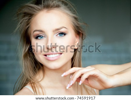 Portrait attractive beautiful woman with blue eyes - stock photo