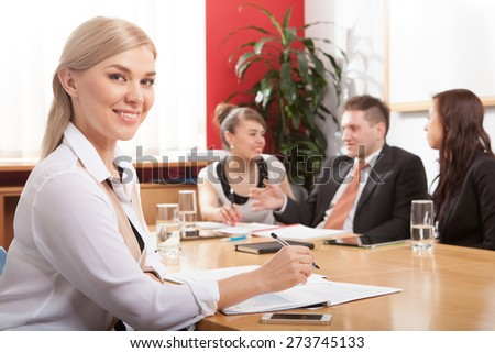 portrait beautiful business woman on the background of business people - stock photo