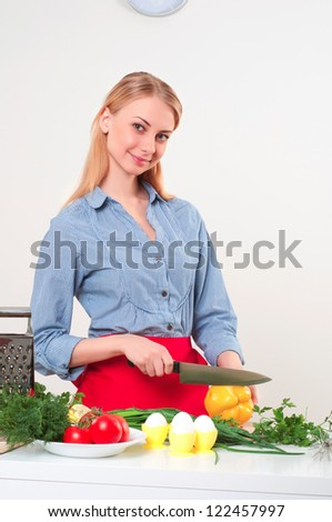 portrait beautiful woman cooking vegetables, healthy lifestyle - stock photo