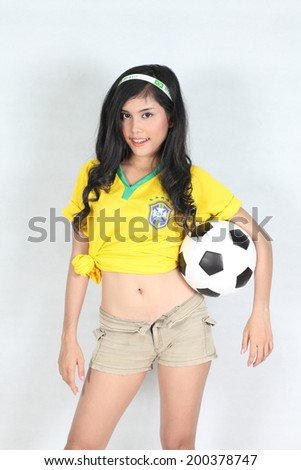 Portrait Beautiful woman  with wearing Brazil football top - stock photo