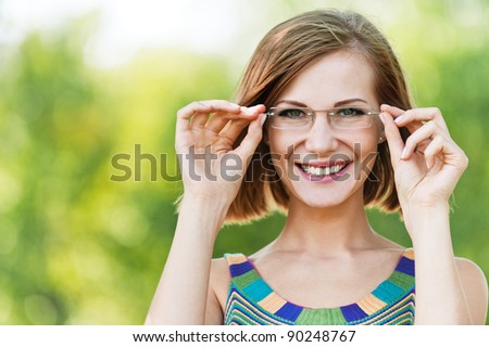 portrait beautiful young woman funny glasses short-haired background summer green park - stock photo