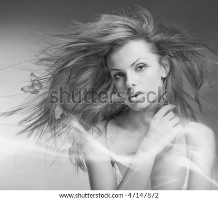 Portrait beautiful young woman with butterfly - stock photo