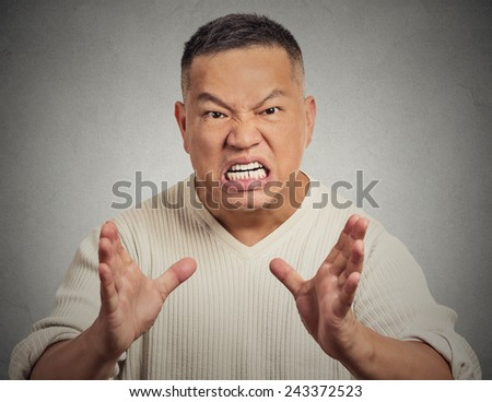 Portrait, bitter, displeased angry, grumpy man yelling screaming isolated grey wall background. Negative human emotion facial expression - stock photo