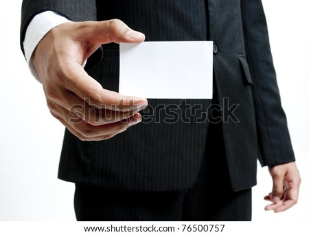 Portrait business man holding blank note card - stock photo