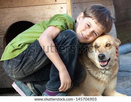 Portrait candid young boy with dog. Positive feeling - stock photo