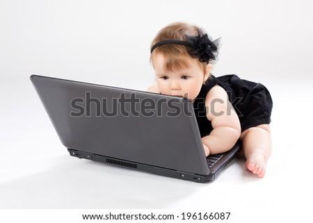 Portrait child with black laptop - stock photo