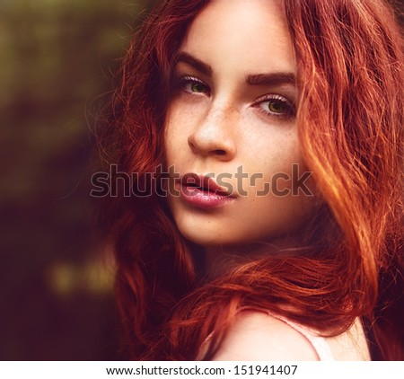 Portrait, close-up face of beautiful young woman with red hair and a sexy look - stock photo