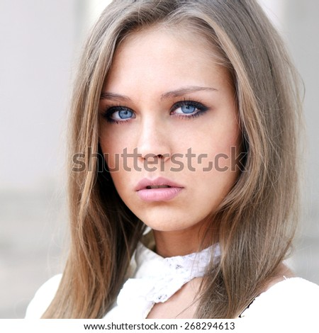 Portrait close up of young beautiful blonde woman - stock photo