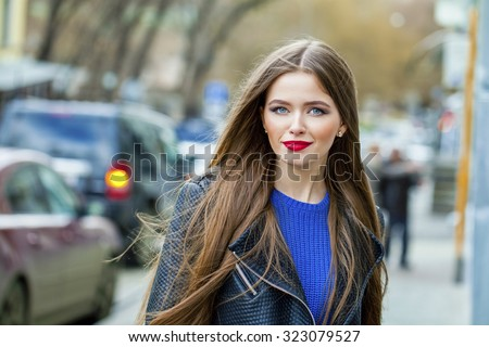 Portrait close up of young beautiful haired woman, on spring street background - stock photo