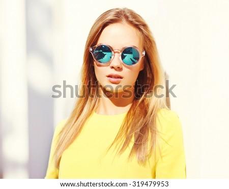 Portrait closeup fashion pretty young woman in sunglasses outdoors - stock photo