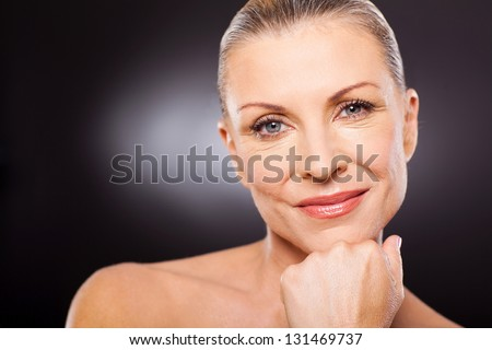 portrait closeup of cute modern woman in her 50s - stock photo
