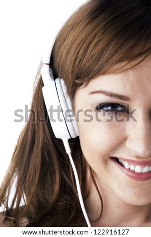 Portrait cropped face of a attractive young female listening to music. - stock photo
