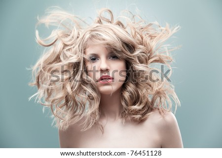 portrait curly blonde wind hair - stock photo