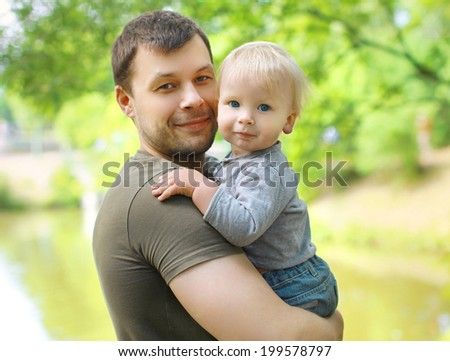 Portrait cute baby and dad in summer - stock photo