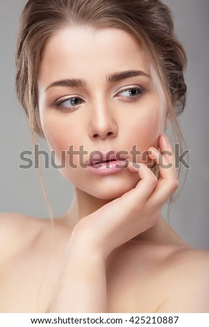 Portrait. Face close-up. Natural makeup. The hand around the lips. - stock photo