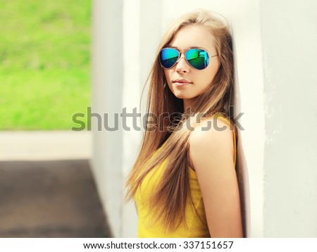 Portrait face girl wearing a sunglasses and t-shirt in city - stock photo