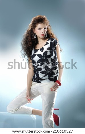 portrait fashion model near the cube on light, background - stock photo